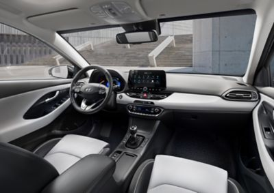 Front interior of the new Hyundai i30 Fastback as seen from the back seat