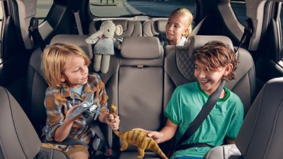 Three children playing in the back of the new Hyundai Santa Fe 7 seat SUV.